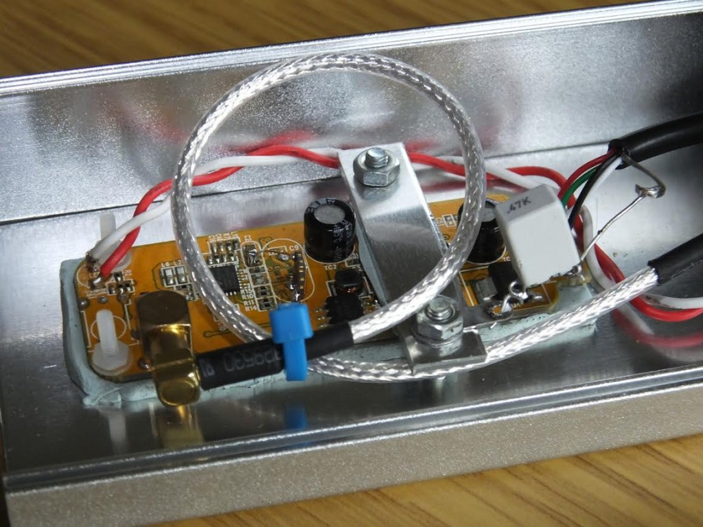 "Inside latest SDR / Latest SDR - ""This is my latest version using a R820T2 version, and I have also fitted this with a TCXO. In this version I also used a 1Mohm and 47nF to ground the USB shield wire as in a previous post. This version only uses one metal spacer and the end  of the PCB is secured by two M2 nylon screws / nuts. Case from China RF on Ebay."""