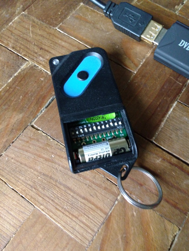 Decoding a garage door opener with an rtl sdr rtl sdr the garage door remote showing the dip switches rubansaba