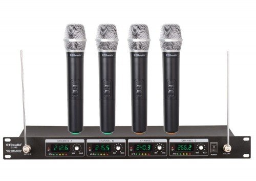 A typical wireless microphone base station and microphones.